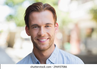Portrait of a handsome smiling man looking at the camera