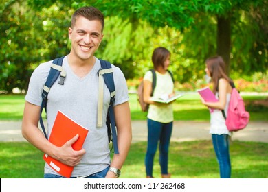 Portrait of an handsome student in a park