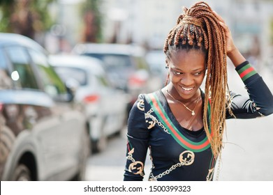 Portrait of handsome stylish african american model woman posed at street.