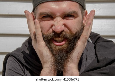 portrait of a handsome thinking man with beard