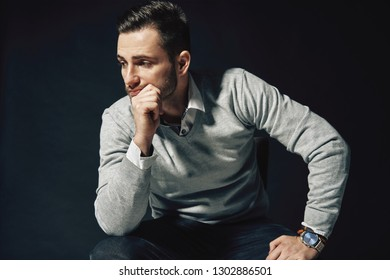 Portrait of handsome thoughtful man touching his chin. Thinking concept