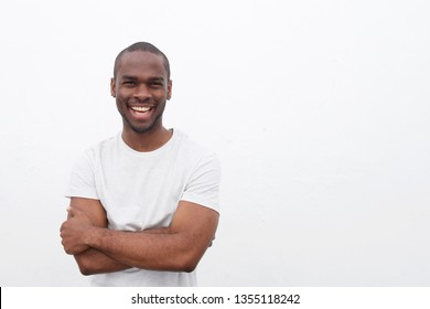 Portrait of handsome young african american man smiling with arms crossed against isolated white background