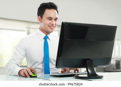 Portrait of a handsome young asian business man working in the office