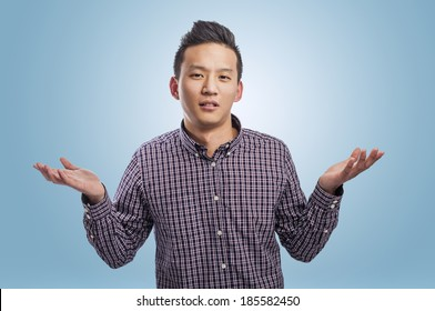 portrait of handsome young asian man dubting