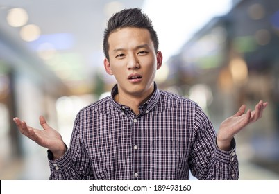 portrait of handsome young asian man doubting