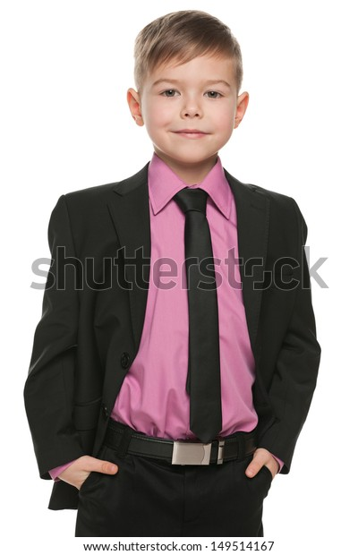 A portrait of a handsome young boy in black suit on the white background