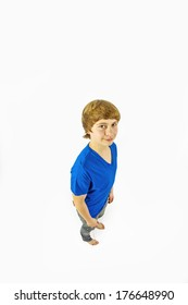 portrait of handsome young boy in studio in wideangle perspective