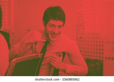 Portrait of a handsome young  business man  on a meeting in offce with colleagues in backgroundduo tone