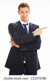 Portrait of a handsome young business man showing something over white background