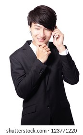 Portrait of handsome young business man using mobile phone, smiling, isolated on white background, model is a asian male