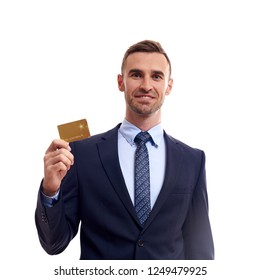 Portrait of handsome young businessman holding credit card over white background.