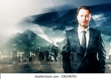 Portrait of handsome young businessman on abstract blue polygon city background. Success concept. Double exposure