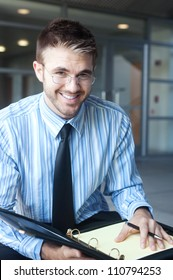 portrait of a handsome young businessman outside