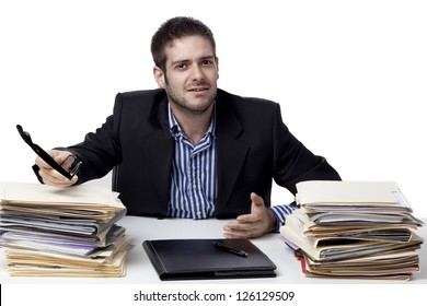 Portrait of a handsome young businessman at work gesturing