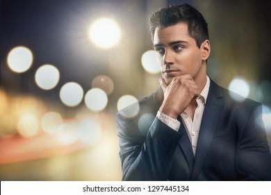 Portrait of handsome young elegant man in suit.