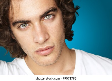 portrait of a handsome young man against a blue background