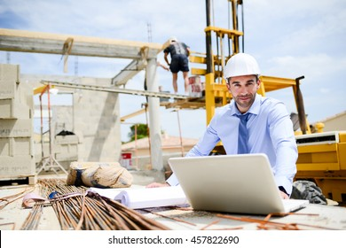 portrait of handsome young man architect on a building industry construction site