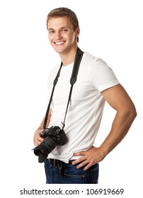 Portrait of a handsome young man with a camera against white background