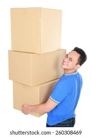 portrait of handsome young man carrying stack of cardboxes