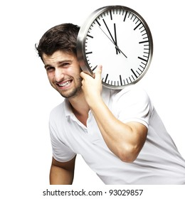 portrait of a handsome young man carrying a clock against a whit