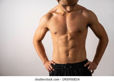 Portrait of handsome young man with clean muscles and skin