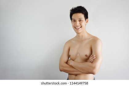 Portrait of a handsome young man cross his arm,smiley at camera ,isolated on white background, Skincare concept