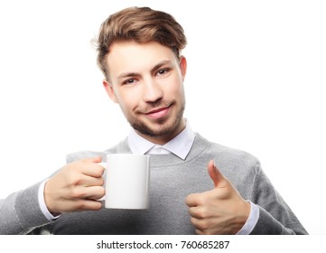 Portrait of handsome young man with cup, isolated on white.