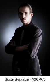 Portrait of a handsome young man in elegant suit.