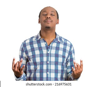 Portrait handsome young man, eyes closed, in meditation zen mode, isolated white background. Stress relief techniques concept take deep breath. Positive human emotions, facial expression sign, feeling