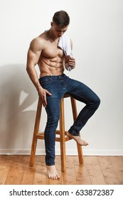 Portrait of a handsome young man with great physique over white background