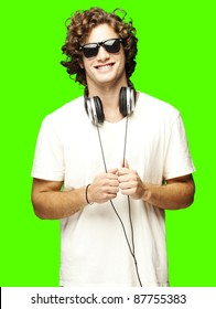 portrait of a handsome young man with headphones over a removable chroma key background