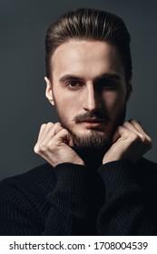 Portrait of a handsome young man. Men's beauty. Studio shot.