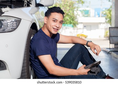Portrait of handsome young man model and car