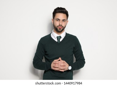Portrait of handsome young man on light background