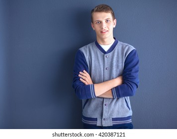Portrait of a handsome young man on black background