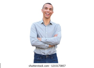 Portrait of handsome young man smiling with arms crossed against isolated white background