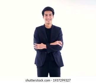 Portrait of handsome young man smiling on white background