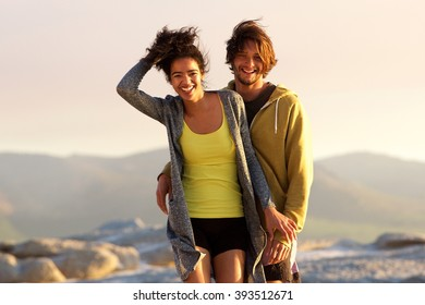 Portrait of a handsome young man and smiling woman outdoors
