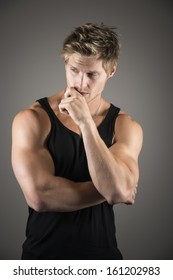 Portrait of a handsome young man with strong muscles and black shirt