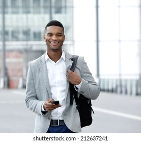 Portrait of a handsome young man text messaging on mobile phone