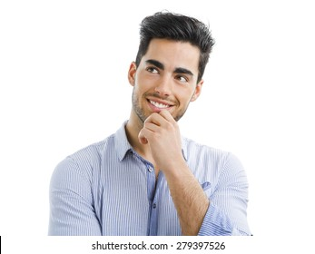 Portrait of a handsome young man thinking on something, isolated on white background