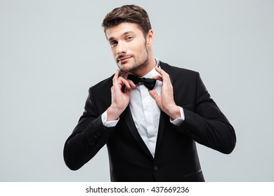 Portrait of handsome young man in tuxedo with bowtie