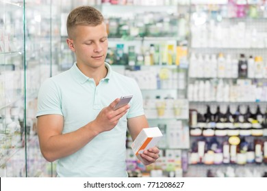Portrait of a handsome young man using his smart phone at the pharmacy taking a picture of medications copyspace technology mobility gadget device searching pharmaceutical consumerism purchase.