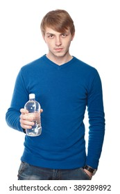 portrait of a handsome young man with a water bottle over a white background