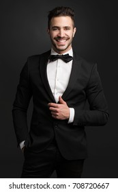 Portrait of a handsome young man wearing a tuxedo