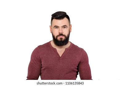 portrait of handsome young serious bearded man isolated on white background