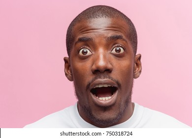 The portrait of handsome young surprised black african man