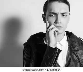 Portrait of handsome young thoughtful man.
