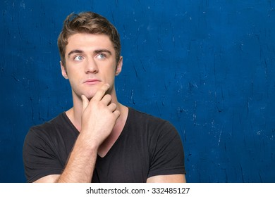 Portrait of handsome young thoughtful man