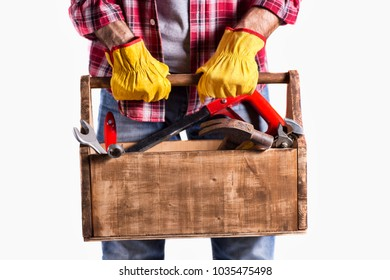 portrait of a handyman with essential tools